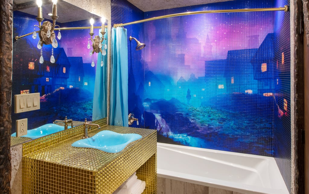 An Elegant Cinderella-Inspired Bathroom With a Mesmerizing Shower Mural