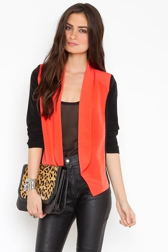 We'd wear this colorblock blazer with white shorts and ankle booties.