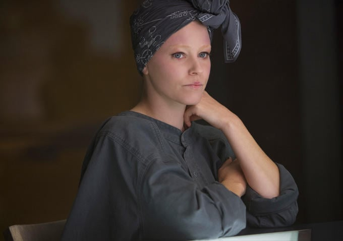 Effie (Elizabeth Banks) has toned down her look for wartime.