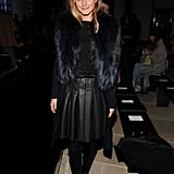 For the Porsche Design presentation, Olivia banished any images of basic black with a pleated leather skirt and luxe fur collar.