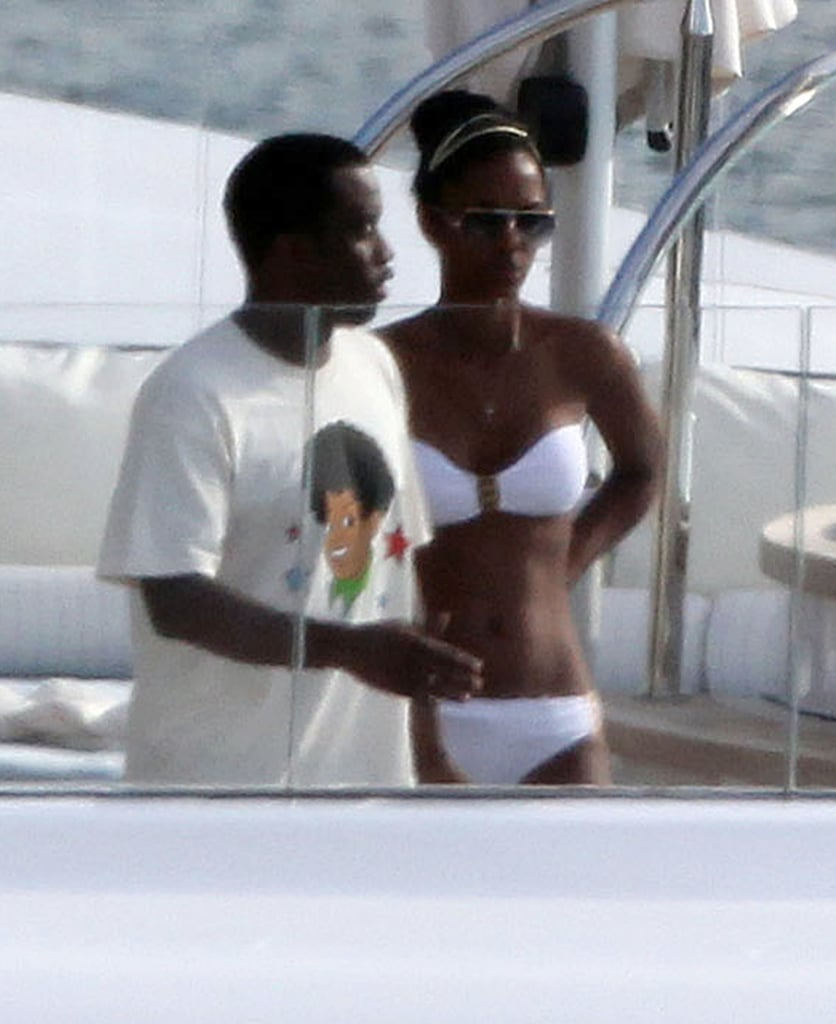 Diddy and his on-again, off-again girlfriend, Kim Porter, were spotted hanging out on his yacht yesterday in St. Barts. She sported a white bikini as they checked out the view from their deck, while Diddy covered up his abdominal assets with a t-shirt. The duo are off enjoying a fun vacation with family, including their 4-year-old twin daughters, Jessie and D'Lila. He spent some quality time with the girls on Monday, freeing Kim so that she was able to lounge at the beach in a yellow two-piece. Diddy got his own chance to have fun in the water, as he was spotted last week riding a huge banana float with friends.