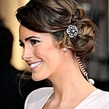 Louise Roe showed us a subtle way to try hair jewellery when she pinned a tiny flower into her soft updo at the Oscars.