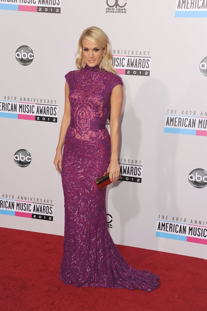 If anyone stole the show tonight, it was Carrie Underwood. The country singer chose a gorgeous purple lace Abed Mahfouz gown, complete with sheer detailing and intricate beading.