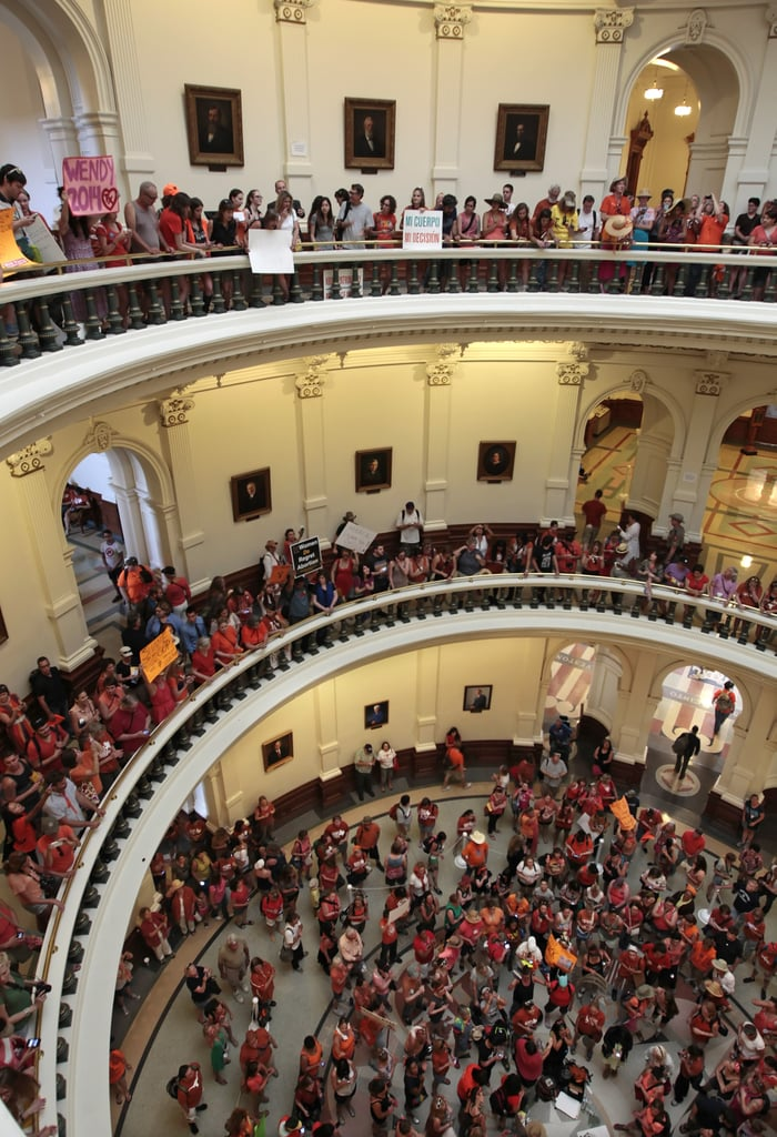 Activists on both sides of the issue filled the Texas Capitol building, cheering and holding up signs.
