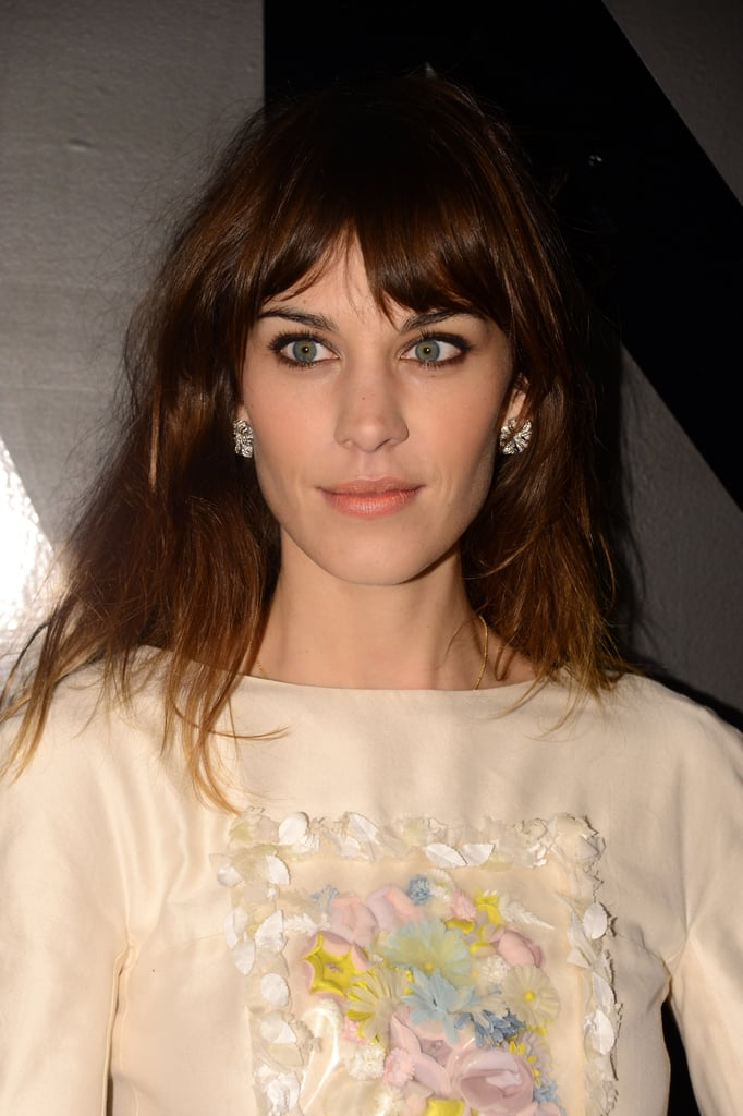 Alexa Chung chose Chanel earrings to complete her look.