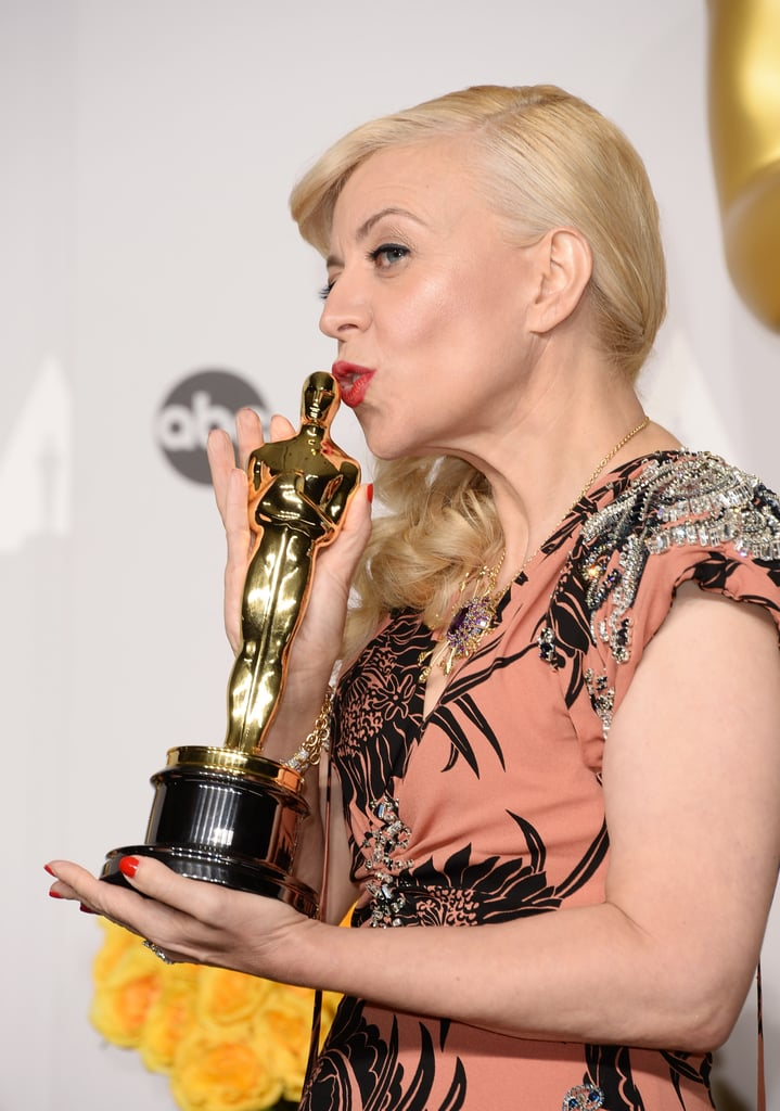 The Great Gatsby's costumer designer, Catherine Martin, smooched her statue. She won best costume design and best production design for her husband, Baz Luhrmann's, film.