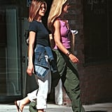 Jen wore a similar style with a classic black tee and cargos in 2001 while out in LA with a friend.