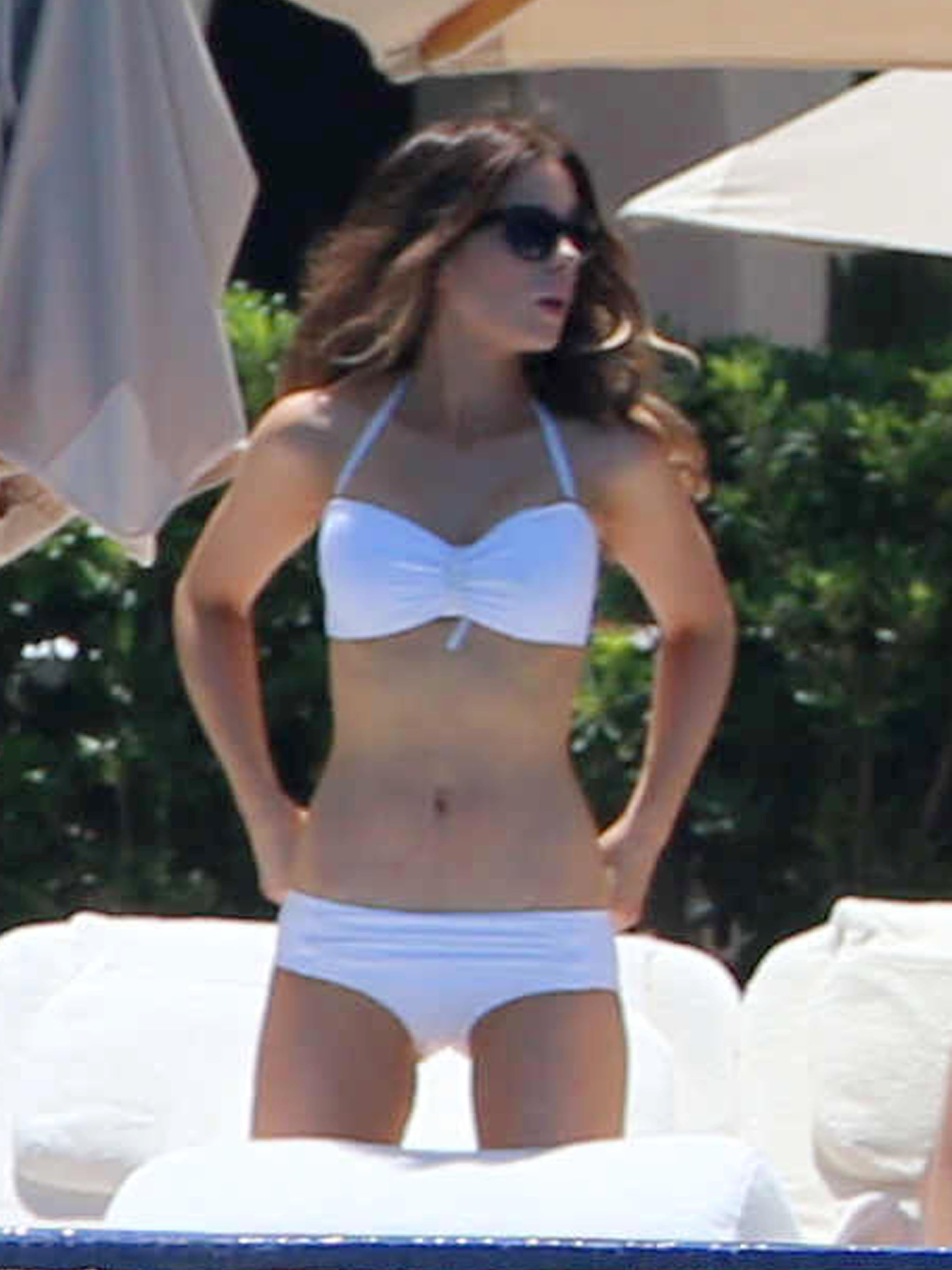 Kate wowed in a white bikini in Mexico in 2013.