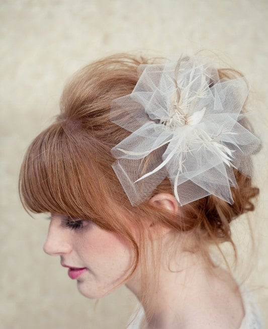 We love the soft tulle pleats on this LoBoheme bridal fascinator ($128).