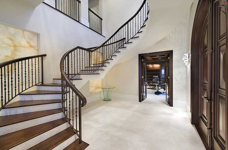 There Is A Grand Entryway With A Sweeping Staircase