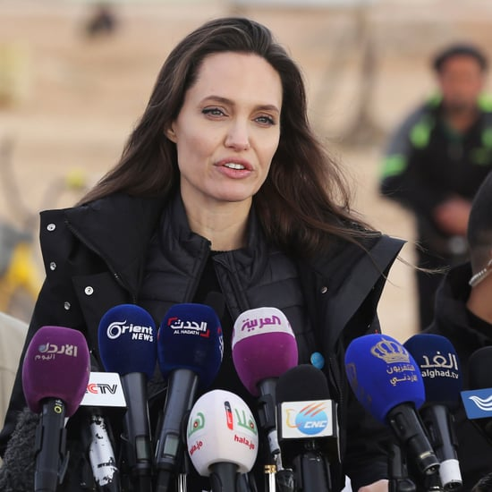 Angelina Jolie Wearing a Black Coat in Jordan
