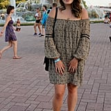 Channeling a boho vibe — complete with a Zara dress featuring off-the-shoulder bell sleeves — looked effortless for this concertgoer.