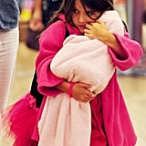 Suri Cruise held tight to her doll.