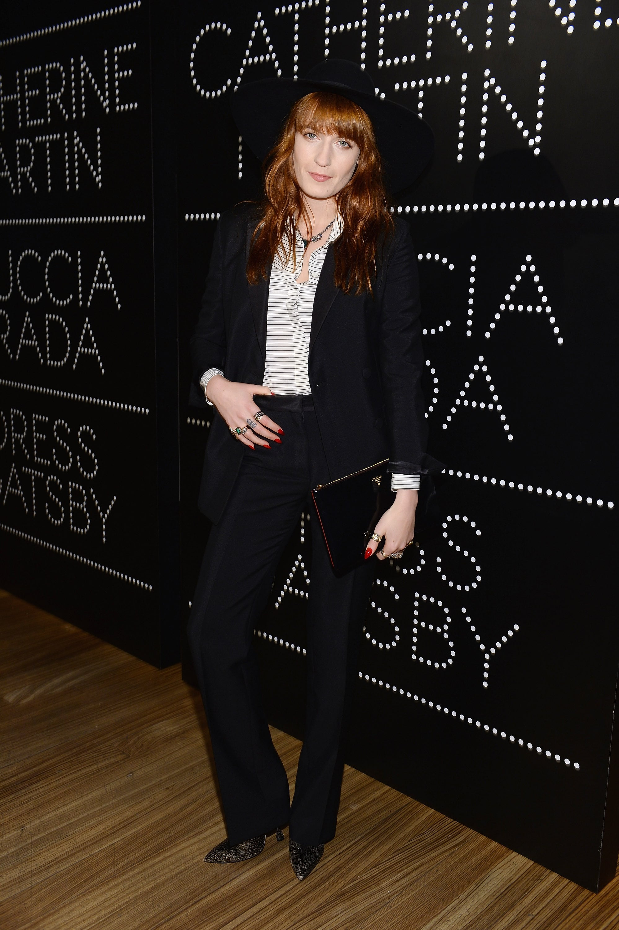 Florence Welch showed off her cool-girl status in black separates made up of a Prada mohair tuxedo, black and white striped silk shirt, and black spazzolato clutch, all by Prada. Black crackled pumps by Miu Miu completed her look at the Prada and The Great Gatsby soiree.