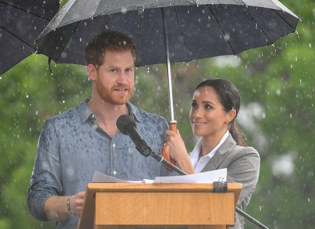 Meghan Markle Holding Prince Harry's Umbrella