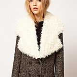How cozy does this ASOS Faux Shearling Lapel Collar ($30, originally $38) look over a tweed coat?