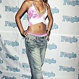 Then: Rihanna was obviously rocking a body chain way before all the ladies who are wearing them now. She showed hers off with a tie-dyed belly shirt that feels so 2000s and low-slung jeans.