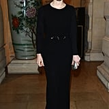 At the CR Fashion Book issue two cocktail party in Paris, Jessica Chastain showed off her svelte figure in a black long-sleeved belted gown, complete with a metallic clutch.