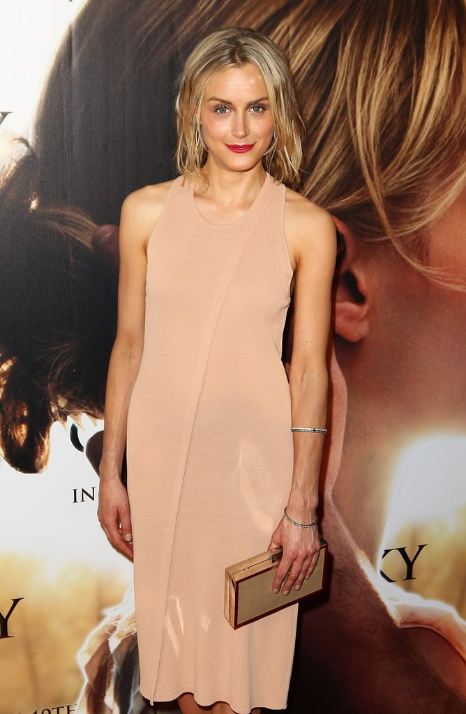 Taylor Shilling wore a nude dress with a gold clutch to The Lucky One premiere in Melbourne.