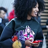 Julia Sarr-Jamois worked her cool-girl sweatshirt and printed pouch combo between shows.