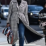 If you're wearing a coat with a loud print, balance it out with plain blue or black jeans.