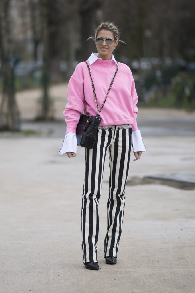 Striped Trousers and a Pink Sweater Worn Over a White Shirt