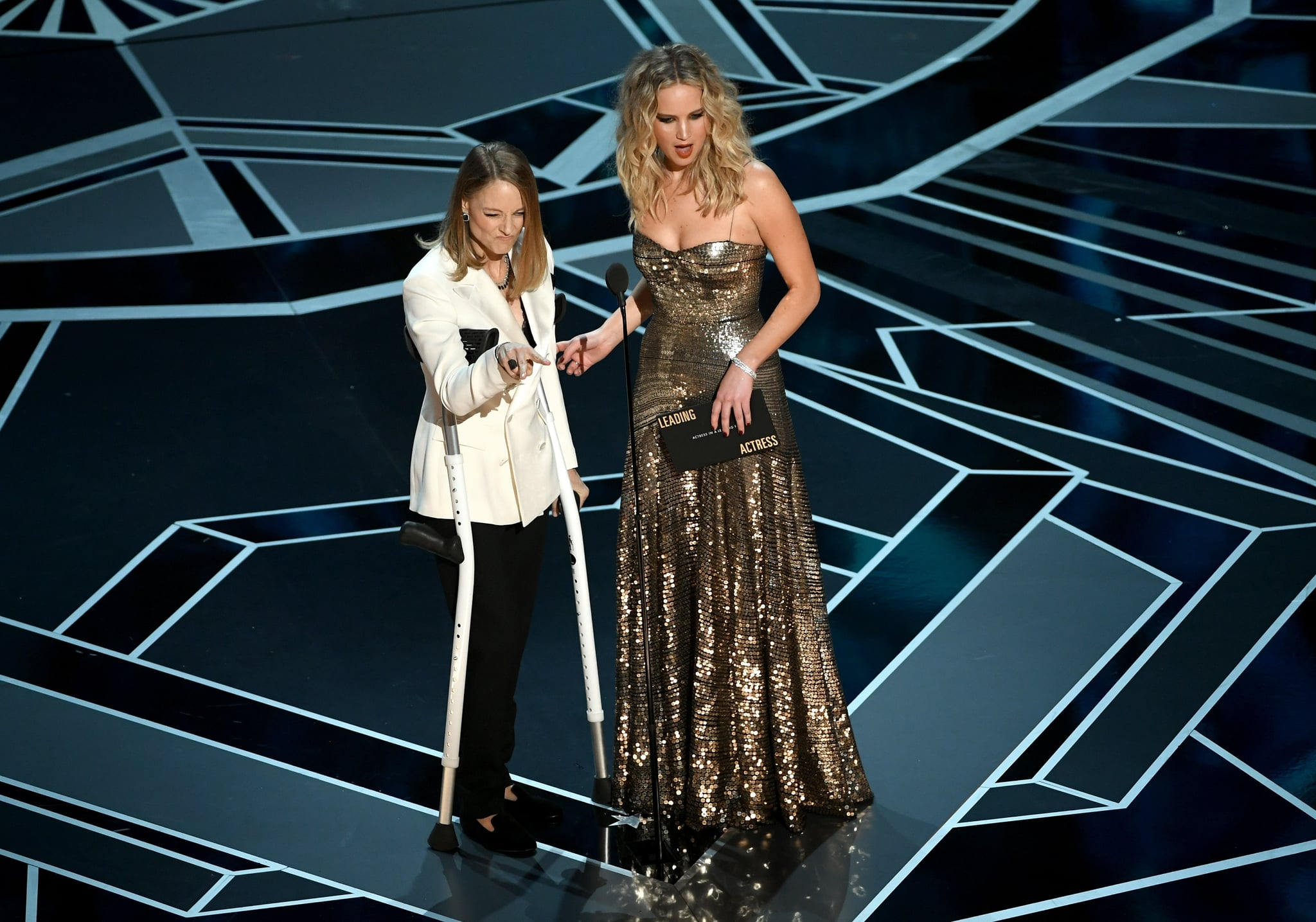 HOLLYWOOD, CA - MARCH 04:  Actors Jodie Foster (L) and Jennifer Lawrence speak onstage during the 90th Annual Academy Awards at the Dolby Theatre at Hollywood & Highland centre on March 4, 2018 in Hollywood, California.  (Photo by Kevin Winter/Getty Images)