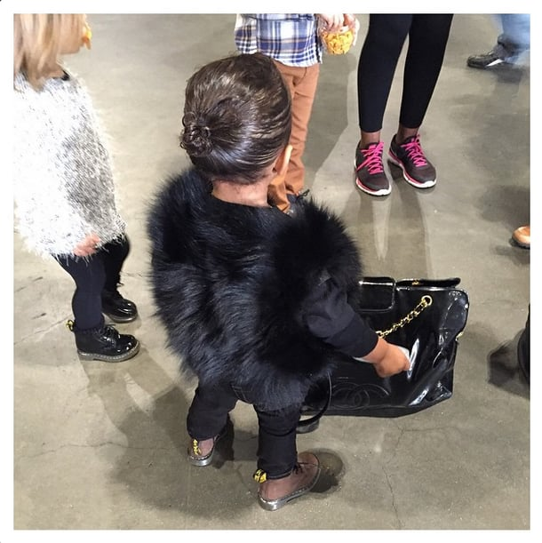 North West Style in Chanel Bag and Furry Vest