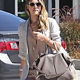 Jessica Alba wore a long necklace and bracelets with her outfit.