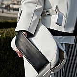 An oversize white clutch featured a bold black strap for maximum color contrast.