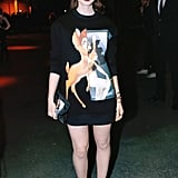 Lily Collins put her legs on display on Sunday at Givenchy.