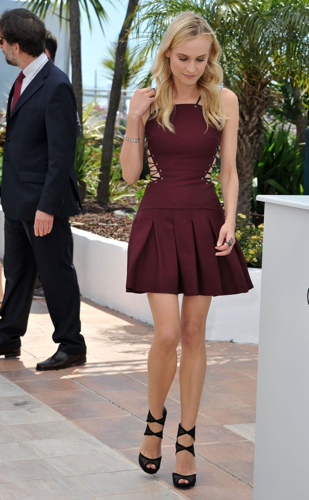 Diane Kruger wore a pleated, lace-up dress by Versus for the jury photocall in Cannes.