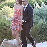 Felicity Blunt went flirty in an orange, printed, flowy minidress and low wedge sandals at Jimmy Kimmel's wedding in July. Follow suit by matching a fun printed number with strappy wedges.