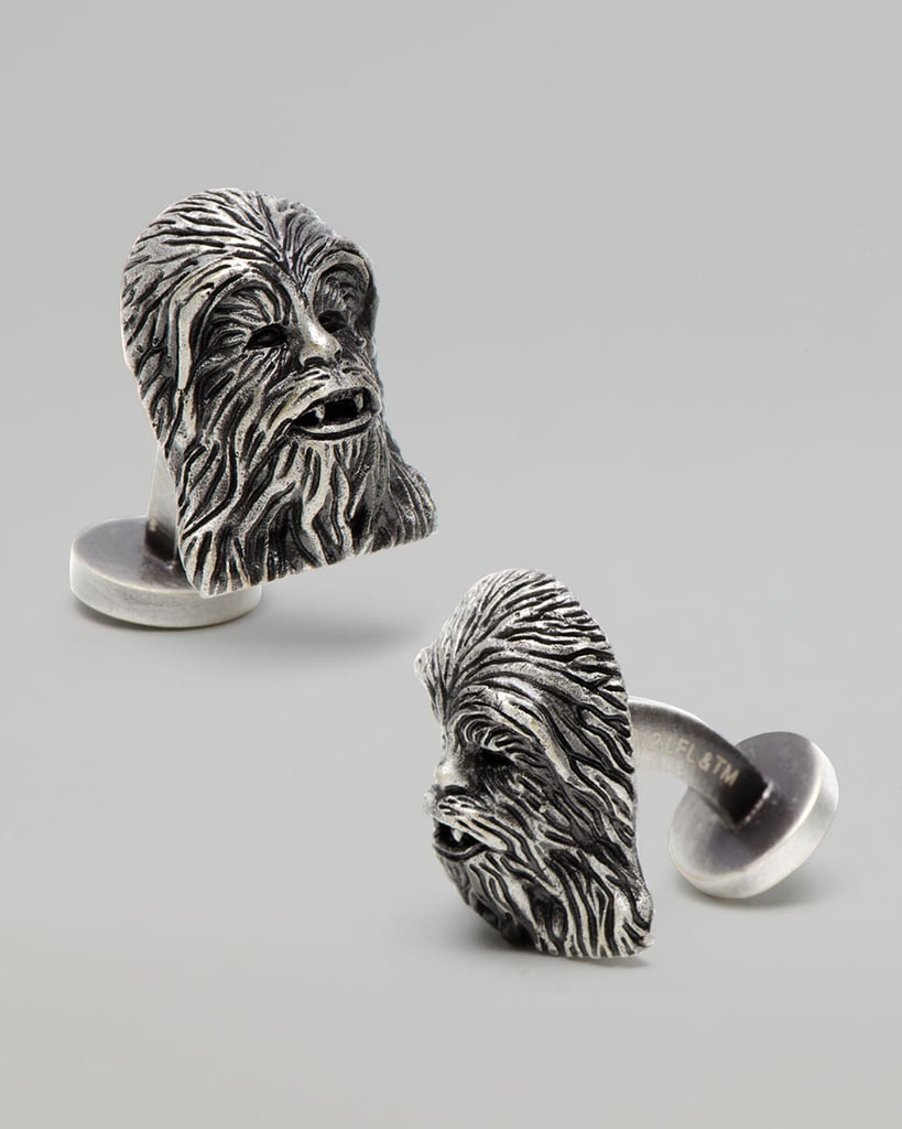 "Ur oh — Wookieespeak for ""thank you"" — is what a recipient will cry when unwrapping a pair of Chewbacca Cuff Links ($125)."