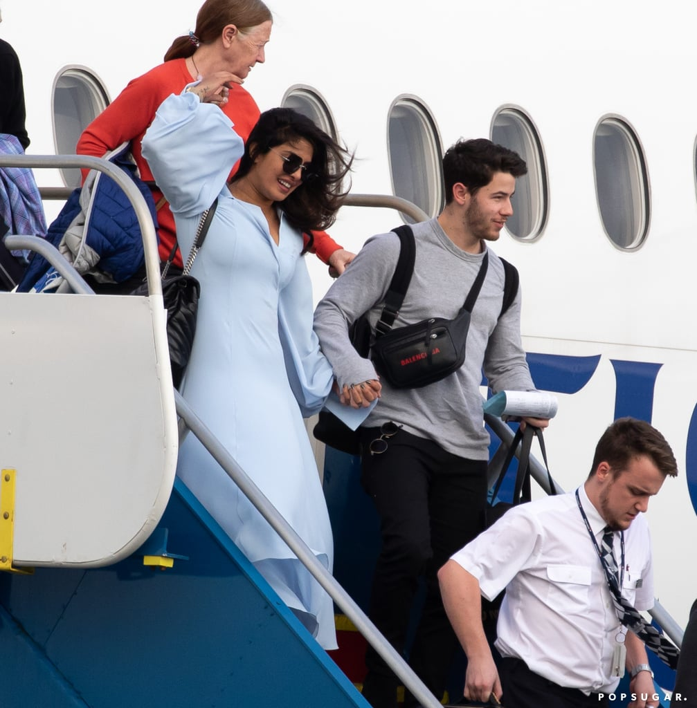 """After a month full of wedding celebrations, Nick Jonas and Priyanka Chopra have officially begun their honeymoon. On Sunday, the newlyweds touched down in the Caribbean following their family vacation in the Swiss Alps. The pair looked ready for some romantic R&R as they held hands while stepping off of their flight. Priyanka donned a pale blue dress, while Nick kept things casual in a gray long-sleeved tee. On Tuesday, Priyanka shared a photo of herself relaxing on the beach on her Instagram stories, and we wish we were doing the same.  Nick and Priyanka's relationship initially started off as a friendship, but things turned romantic when they started dating in May 2018. Nick popped the question to Priyanka during her 36th birthday celebration in July 2018, and five months later, they tied the knot in a series of ceremonies in India. From the looks of it, Nick and Priyanka are enjoying married life!      Related:                                                                                                           Consider Us Jealous! Nick Gushes About His """"Instant"""" Connection With Priyanka Chopra"""