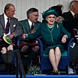Queen Elizabeth II watches at the Braemar Gathering in 2007