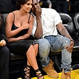 Kim Kardashian was definitely dressed up for this May 2012 Lakers playoff game, but we love her black strappy leather dress and matching lace-up heels. When you're sitting courtside with Kanye West, why not go all out?