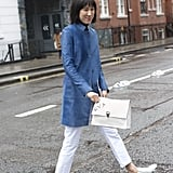 With a Light Blue Coat and Casual Slip-Ons