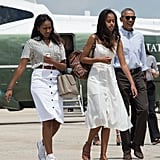 Barack boarded Air Force One with his daughters as they left for a two-week holiday in Martha's Vineyard in August 2016.