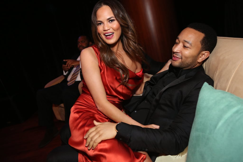 Soon to be newlyweds John Legend and Chrissy Teigen cozied up on a couch Sunday night at the Hip-Hop Inaugural Ball II.