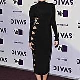 Miley Cyrus walked the red carpet in a black turtleneck dress.