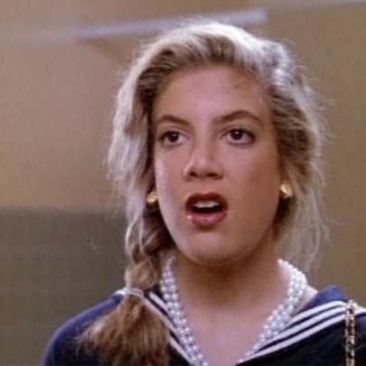 Donna, sporting a side braid, is horrified to discover that she has put both contacts in one eye.