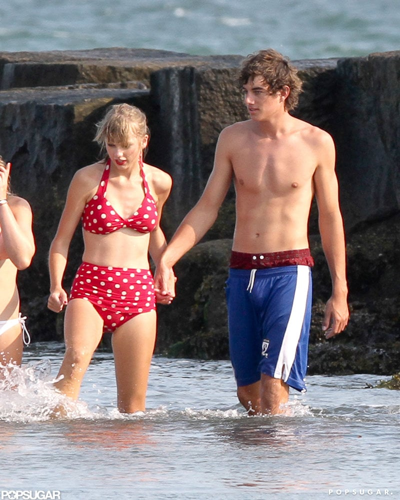 "Taylor Swift and her boyfriend Conor Kennedy held hands in the ocean off the coast of Cape Cod on Friday. Taylor and her 18-year-old guy have been spending lots of time together this Summer, starting with the Fourth of July when she was first spotted with the famous family. Taylor's polka-dot bikini has been a favorite of hers as she enjoys East Coast living. Taylor is so enamored with the area that she reportedly bought a house near the Kennedy compound in Hyannis Port, MA. Taylor will soon be trading in her swimsuits for life on the road, promoting her new album, Red. She released her new single, ""We Are Never Ever Getting Back Together,"" last week, and the catchy tune is already breaking records."