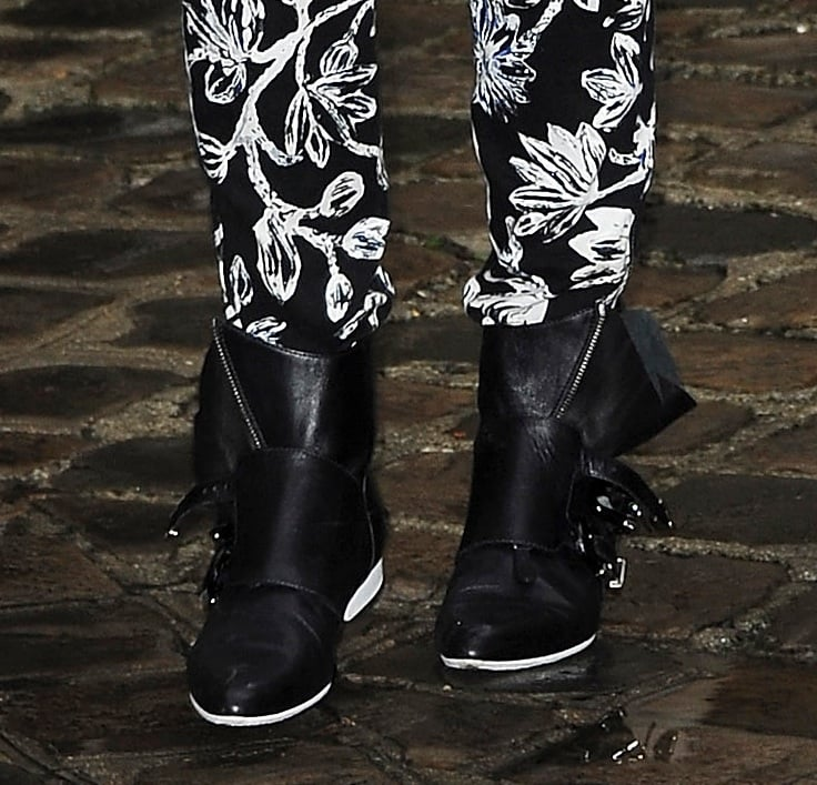 A close-up on Kristen's slouchy buckled ankle boots — these would look amazing with a midi-length dress, too.