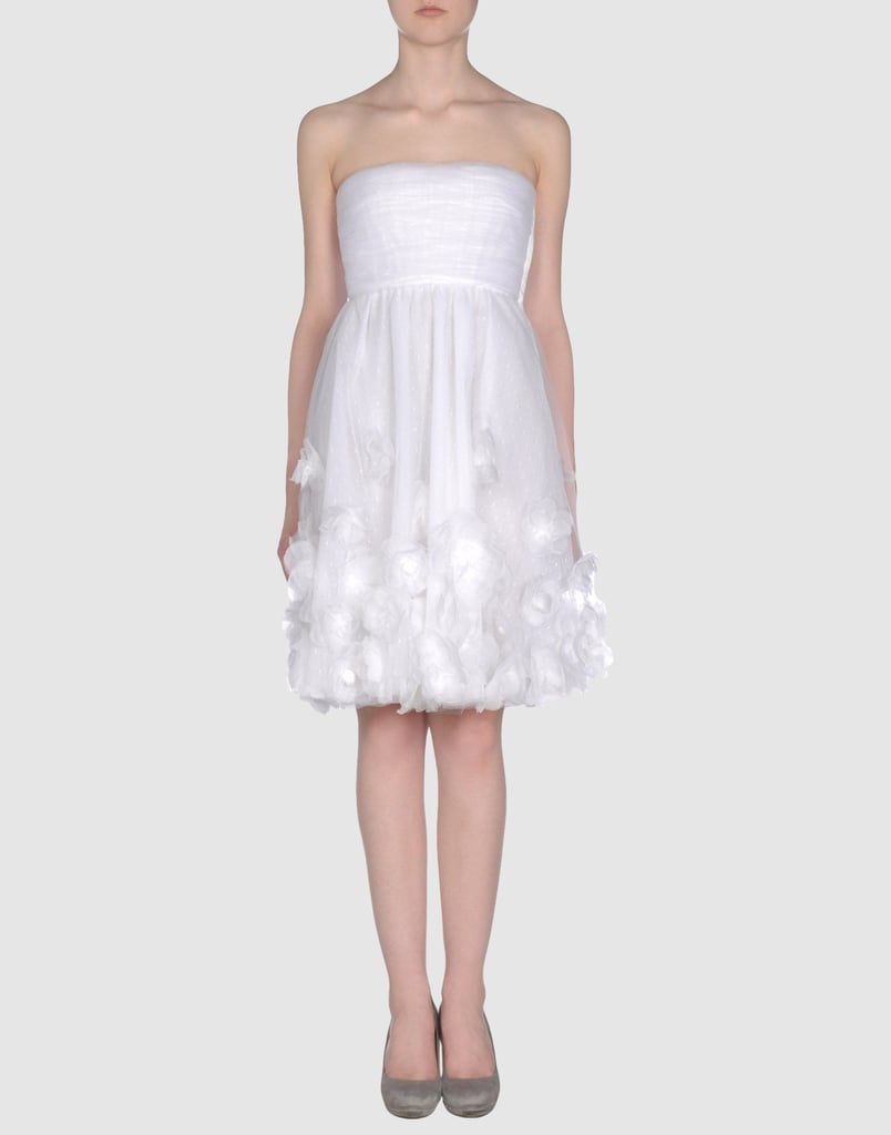 This little strapless has a unique ethereal quality that's just as well-suited to an outdoor or indoor ballroom with the right footwear.  Valentino Wedding Gown ($4,448)