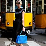 If your LBD has any colored embellishments, play it up by coordinating accessories. An oversize blue handbag, for example, will help infuse a jolt of interest.
