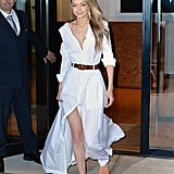Later, for an appearance on The Tonight Show, Gigi belted an Adam Selman shirtdress that featured a front slit, all the better to show off the new shoes she helped design.