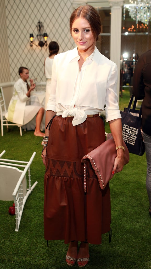 Olivia Palermo paired a slouchy oversize, studded Valentino clutch with her Fashion-Week ready ensemble.