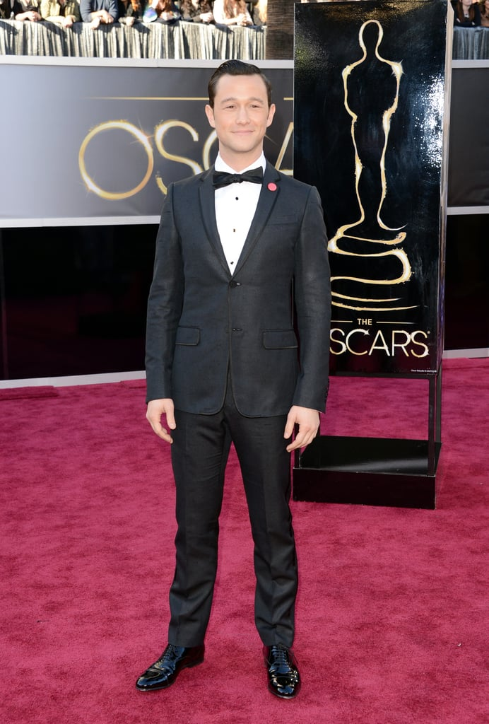 Joseph Gordon-Levitt looked sharp in a suit when he arrived at the Oscars tonight in LA. He isn't nominated for any awards, but he will be performing a number with Daniel Radcliffe and Seth MacFarlane. Joseph didn't reveal too much about his performance, only noting that he was going to be doing something with Daniel and Seth during the opening number. However, he did squeeze in some fun on the red carpet when he posed for photos and did interviews with Sally Field. Be sure to weigh in on the top red-carpet looks in our Oscars fashion and beauty polls.
