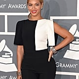 Beyoncé's Osman by Osman Yousefzada jumpsuit got a jolt of mod thanks to her matching geometric bangles.